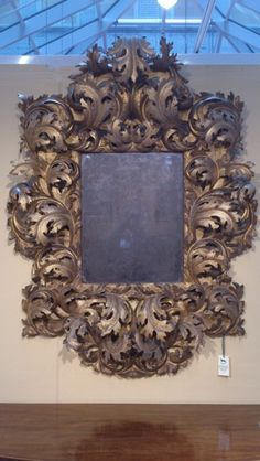 Italian Mirror, 1680  Antique Rococo Mirror Very rare 17th century carved wood and gilded Rococo mirror with lovely old glass, the interesting thing about this mirror is the scale of the carving and the generosity of the form, quite theatrical and simply wonderful, Italian circa 1680