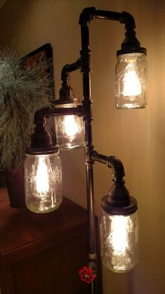 Steampunk/Industrial floor lamp with pipes and mason jars steampunk room pi Diy Tisch, Lampe Tube, Industrial Floor Lamps, Industrial Pipe, Rustic Floor Lamps, Industrial Living, Pipe Lighting, Lighting Ideas, Pendant Lighting