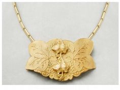 """ART NOUVEAU BELT BUCK BECOMES A NECKLACE. AUTHENTICATED 1901. 20% DISC. thru August 30.  3.25 x 2.25"""" belt buckle has become a necklace with the use of an 18"""" stretchy watch fob from the early 19th century. Priced at $250, save $50 if ordered by August 30. Made of  Brass and Bronze.  It can revert back to a belt buckle again, because nothing has been done to infringe on its original purpose.  Incredible condition. FREE POSTAGE WITHIN THE US. BUYER PAYS POSTAGE FOR INTL WORLDWIDE, EXPEDITED."""