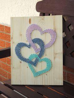 Enfilade de coeurs en string art