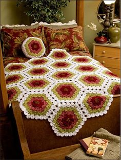 This geometric crochet afghan will add lot of color to your home.  What colors would you make it in?