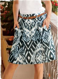 A tribal ikat looks fresh for summer printed in blue and white on a crisp Italian fabric. The skirt is tailored with inverted pleats that release beneath a flat yoke; lined.