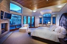I would so have sex in this bed. Windows  surround it. Beautiful scenery. So romantic