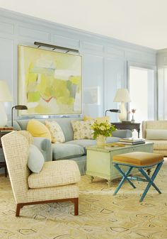 Formal Living Room with pale blue lacquered walls, abstract painting above the blue velvet sofa, via @sarahsarna.