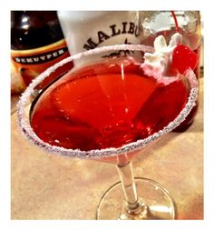 Cotton Candy    1 oz Malibu Rum    1 oz Peach Schnapps    1/2 Grenadine    Pour ingredients into an ice filled shaker and:  Shake shake shake. then strain into a martini glass, garnish with cotton candy, whip cream, a cherry or if you're feeling extra adventurous, all three!