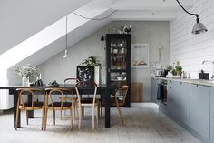 Kitchen and dining space in a Scandinavan attic apartment