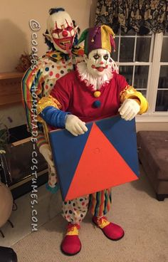 Scary Clown Carrying A Jack In The Box Illusion Costume...
