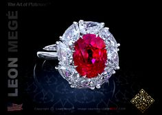 Custom made cluster ring featuring an oval shaped ruby by Leon Mege.