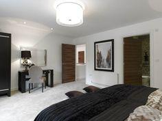 Walnut internal doors offer stunning timber graining and look great in this bedroom.  JB Kind's Walnut Flush - Fernor #walnutdoors