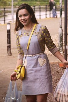 The perfect outfit for running errands. An overall jean jumper dress and yellow cross-body bag. | Me Before You Movie | In Theaters June 3
