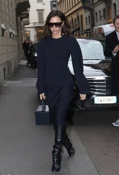 Blue: The star was clearly pensive as she walked along the streets of Milan to the venue, ...