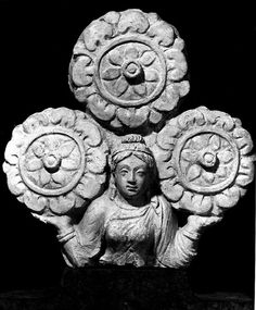 """Female figure, holding up a triratna(?)  From Hadda, Afghanistan  stucco  H: ca. 9""""  Kabul Museum, Kabul  Photograph taken in 1970"""