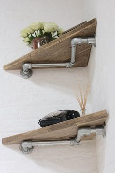 Vikki Pair of Reclaimed Wood Corner Shelves with W shaped Galvanised Steel Pipe Wall Brackets - Their salvaged vintage industrial design works perfectly in a sophisticated, casual living space.  These shelves can be made to measure to your own specifications. The shelves pictured here were 580mm deep x 580cm wide... but the skys the limit... these shelves can be made with dark steel pipe and fittings and any diameter of pipe and any finish on the boards.... scaffolding boards could be…