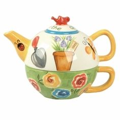 It's hard to resist this adorable teapot for one with a teapot and cup combination and robust colors.  This garden variety is hand-painted in a garden motif with a watering can on the top. It makes us think of afternoon tea on the porch.  Made of Ceramic.  16 Ounce Capacity.