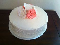 Sugar flowers on a simple white cake