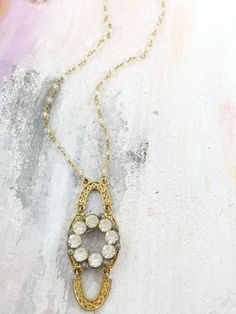 """""""Because You Laughed"""" - Mid-century filigree open work medallion layered under a 1950's rhinestone brooch on beaded Quartz chain"""