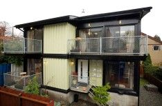 Shipping Container Home In Glazed Domination Beautified With Small Plants