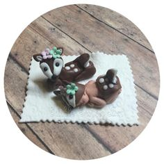 "** FREE SHIPPING**Fondant baby shower cake topper includes: 1 Fondant baby 2 1/2"" long in deer outfit with flowers Mama deer  1 4"" blanket"