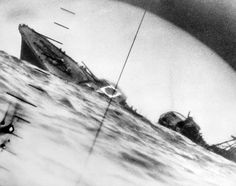World War II, the sinking of a Japanese destroyer as viewed from the periscope of the American submarine that sank it, July 25, 1942