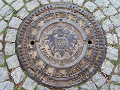 Manhole cover in Cologne - by /entolin, via Flickr -