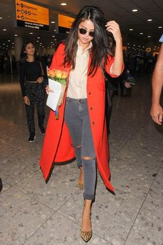 WHO: Selena Gomez WORE: Atea Oceanie shirt, Topshop jeans, Prada purse, and Loeffler Randall shoes