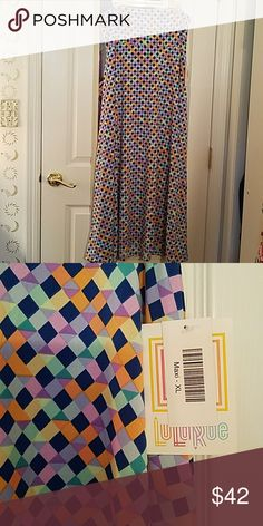 Stunning LulaRoe Maxi Multi-colored pattern. Navy, melon, teal, mint, lavender.  Gorgeous on, I love, love, love it but it's too big :( . Stretchy. Soft, silky.  Never worn. I'm a true size 16, so I apparently need a Large maxi. Sad to sell this. LuLaRoe Skirts Maxi