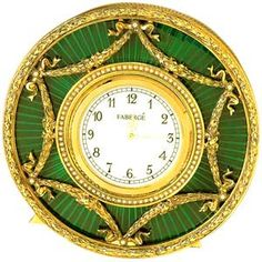 from the workshop of Peter Carl Fabergé: silver, gilt and green guilloche enamel, porcelain face of the clock, silver gilt hands and black Arabic numerals