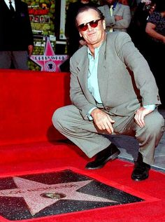 December 1996: Jack Nicholson poses in front of his star after he was honored on the Hollywood Walk of Fame.