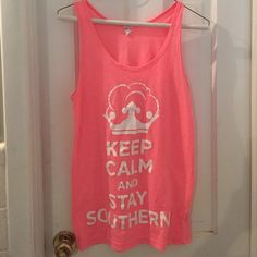 """SOLD Keep Calm and Stay Southern Tank Cute Southern """"keep calm and stay southern"""" tank top, bought from Country Club Prep, American Apparel brand. Neon pink. Worn a few times. Shows slight signs of wear with minor pilling if you closely inspect, but price reflects this. Perfect for summer! Size small! American Apparel Tops Tank Tops"""