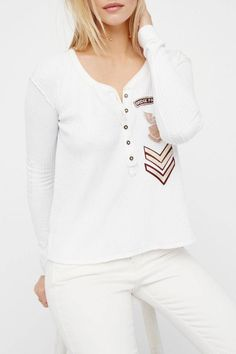 Long sleeve waffle Henley tee featuring borrowed-from-the-boys patch accents and contrast details on the elbows. Easy, effortless high-low shape with small side vents.    Bridget Tee by Free People. Clothing - Tops - Tees & Tanks Hudson Valley, New York