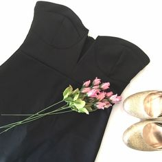 Fitted Black Dress NWOT Black short dress. Has cleavage cutout. 90% Polyester 10% spandex. Size Large. Never worn and in perfect condition. Stella  Dresses Mini