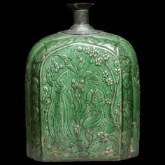 Univers Mininga - This is a flask with a flattened body, thought to have been made in the early 17th century. Made in Isfahan, Iran out of siliceous clay paste ware, molded decoration under a coloured glaze, it has a height of 22.5 cm. It is currently in the Louvre.