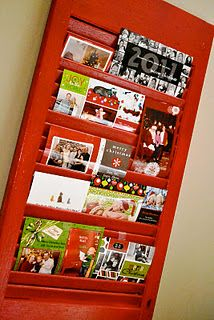 Christmas cards displayed in an old shutter...LOVE!!!  I'm thinking this is also good year round to sort mail. Maybe paint to match your interior, adds couple gold hooks for keys and dog leashes. Hang in the entry of the kitchen? Yes!