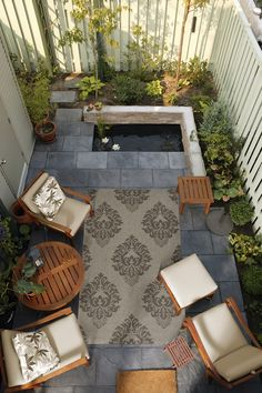 Small outdoor space brought together by a Surya rug from the Elements Collection (ELT-1003).