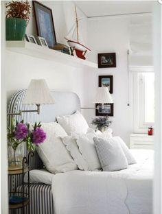 blue and white ticking headboard, white bedding