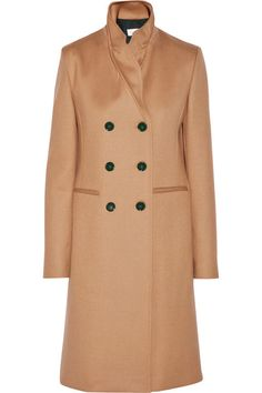 A double breasted version with high neck detail is a standout. Victoria Beckham coat, $3,800, net-a-porter.com.