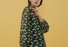 With bell-shaped sleeves sculpted to an elasticated cuff, the black netting and underlying camisole provide the perfect backdrop to the embroidered yellow flowers that blossom over this dark meadow.  <br/><br/>  Designed to be a relaxed boxy fit .
