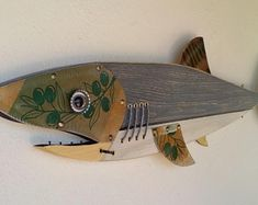 Shark made with Wood, Metal,Glass, Handmade by Unikos Arts Give your wall a upcycled beach steampunk theme with one of a kind original distressed Fish wall art sculpture. Metal Fish, Wooden Fish, Fish Sculpture, Wall Sculptures, Record Crafts, Steampunk Theme, Jellyfish Art, Fish Wall Art, Scrap Metal Art
