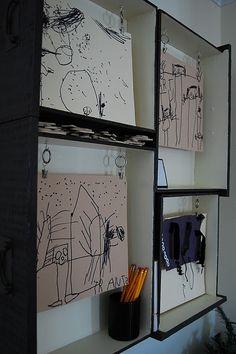 Dresser Drawer Art Display Case...drawers were found in the trash, hung and cup hooks with curtain rings screwed in to hang kid's artwork...