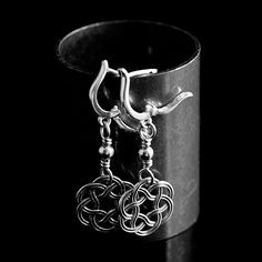 These Celtic circle knot earrings are solid Sterling Silver measuring 1 3/4 inches long and 5/8 of an inch wide. They are simple yet elegant and