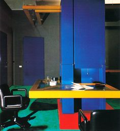 colors. wrap-around desk. floor. | 1970's home of architect Romano Juvara; Milano, Italy