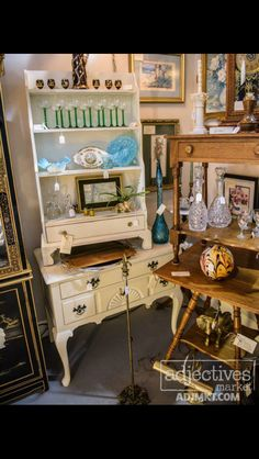 """Lowboy Chest - Painted white  $210.   French Step-Back Cupboard with drawer - Painted White and lightly distressed  $185 Black/gold Decanter w/ 6 Cordials  $69 Turquoise Art Glass Bottle $49  Side Table w/ Drawer Hand Cut Dove Tail Drawer - Hand Cut Nails - dating this between 1810 - early 1900s     $149  13 1/2"""" Brass Elephant  $55 -- SOLD Available at Adjectives Vintage Market, Altamonte Springs, FL"""