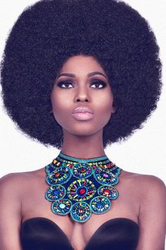 Retro Afro Hairstyle. This is the kind of fro my dad had growing up. It's very neat and geometric. :)