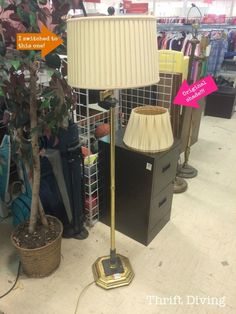 Have you ever walked past and ugly lamp like this at the thrift store? Next time, BUY IT! Glue pretty paper to the lampshade and paint the body to create a DIY lamp makeover!