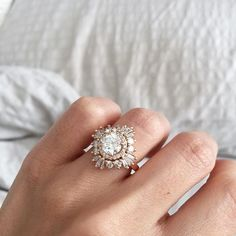 I would love this with the stones I want. Purple diamond center, diamond halo, aquamarine(sea green-blue) around the outside. More rounded on the outside maybe? Heidi Gibson