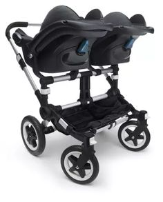 """I saw a tagline on Bugaboo's website—a Dutch company specializing in  strollers—stating, """"Going out with twins has never been easier—or as  comfortable!"""" Oh, yeah? I have twins. Nothing about going out with them  is easy. And if anyone is going to be comfortable while we are out, I  want it to be me. But, I am always willing to take suggestions on making  my life easier, so I kept most of my snarky comments to myself and read  more about the Bugaboo Donkey Twin stroller. It's pretty sweet."""