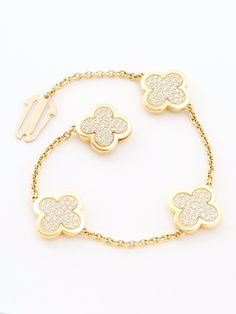 Van Cleef & Arpels 18K Alhambra Four Motif Pave Bracelet. Yellow Gold Bracelet with Four Pave` Diamond Clovers. The total Diamond Weight is 1.78ctw.