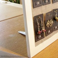 How to create your own earring card display from a frame. Great idea and easily broken down to be packable!