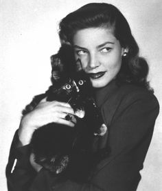 Lauren Bacall and her cat. Aww, a tortie girl... With such distinct face markings! Love both. <3 Lauren Bacall was the best.
