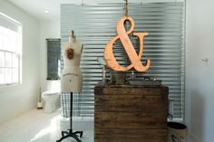 Corrugated metal makes a perfect privacy screen in this farmhouse bathroom eclecticallyvintage.com